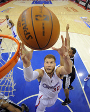 Los Angeles Clippers forward Blake Griffin, left, grabs a rebound as San Antonio Spurs forward Boris Diaw of France, right, reaches in during the first half in Game 4 of an NBA basketball playoffs Western Conference semifinal, Sunday, May 20, 2012, in Los Angeles. (AP Photo/Mark J. Terrill)