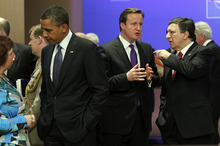 From left, President Barack Obama, British Prime Minister David Cameron, and European Commission President Jose Manuel Barroso talk before the start of the opening session of the North Atlantic Council at the NATO Summit in Chicago, Sunday, May 20, 2012. (AP Photo/Pablo Martinez Monsivais)