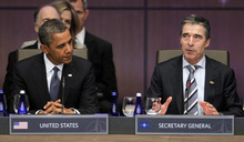 President Barack Obama stands looks to NATO Secretary General Anders Fogh Rasmussen during the opening session of the North Atlantic Council at the NATO Summit in Chicago, Sunday, May 20, 2012. (AP Photo/Pablo Martinez Monsivais)
