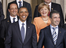 From left to right, French President Francois Hollande, President Barack Obama, German Chancellor Angela Merkel and Secretary General Anders Fogh Rasmussen, during the NATO family photo at Soldier Field at the NATO Summit in Chicago, Sunday, May 20, 2012. (AP Photo/Pablo Martinez Monsivais)