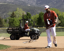 Cobb Condie | Special to The Salt Lake Tribune Southern Utah baseball players, Bryson Kenolio, left, and Mitchell Kauweloa take part in post-game groundskeeping duties for the last time after the baseball program's last home game ever on May 12.  The Thunderbirds lost to South Dakota State 11-9.