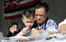 Sarah A. Miller  |  Tribune file photo Keola Ohumukini of Salt Lake City helps his grandson Kealii Ohumukini, 3, make handmade traditional Hawaiian leis and bracelets at the 2011 Living Traditions Festival. This year's festival runs through Sunday at the Salt Lake City & County Building.