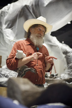 Robert Bakker, the museum's curator of paleontology, talks in the new Hall of Paleontology at the Houston Museum of Natural Science Tuesday, May 15, 2012. The $85 million wing of the museum that opens June 2 will have the only Triceratops skin found to date and a unique T-rex fossil with complete hands.(AP Photo/Michael Stravato)