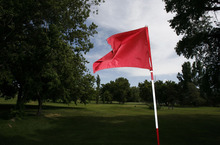 Francisco Kjolseth  |  The Salt Lake Tribune Wind kicks up the flag on hole No. 7 on the Jordan River Par-3 Golf Course in Rose Park, where few were playing on Monday, May 21, 2012. The golf course is under consideration to close as the Salt Lake City Council has its annual budget deliberations.