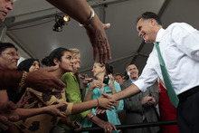 Republican presidential candidate, former Massachusetts Gov. Mitt Romney, greets Sarita Weltman before speaking at a campaign stop at the River City Brewing Company, Thursday, May 17, 2012, in Jacksonville, Fla.  (AP Photo/Mary Altaffer)