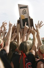 Paul Fraughton / Salt Lake Tribune The Bear River softball team hoists the 3A championship trophy into the air after their win over  Spanish Fork.   Monday, May 21, 2012