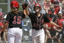 Paul Fraughton / Salt Lake Tribune In the first game between Spanish Fork and Bear River, it was all Spanish Fork. Sydney Butler and Dani Perkins celebrate another run in game one.   Monday, May 21, 2012