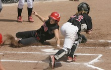 Paul Fraughton / Salt Lake Tribune Bear River's Erin Fox touches home plate as she slides under the tag attempt by Spanish Fork catcher Dani Perkins.   Monday, May 21, 2012