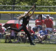 Paul Fraughton / Salt Lake Tribune Bear River's Morgan Summers makes a leaping  catch in right field for the out. Bear River defeated Spanish Fork for the 3A state championship in softball.   Monday, May 21, 2012