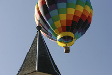 Scott Sommerdorf  |  The Salt Lake Tribune              During the early part of the dedication ceremony on Saturday, a hot air balloon floated over the old tabernacle building. The LDS Church broke ground for the Provo City Center Temple, formerly known as the Provo Tabernacle.