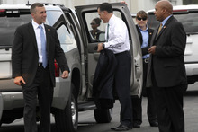 Republican presidential candidate, former Massachusetts Gov. Mitt Romney is surrounded by members of the Secret Service as he arrives in Jacksonville, Fla., Thursday, May 17, 2012.  (AP Photo/Mary Altaffer)