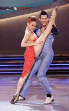 Jessica Fernandez, left, and Jaymz Tuaileva perform a '70s disco dance routine on