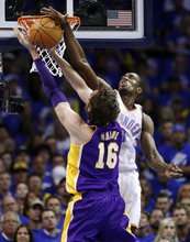 Oklahoma City Thunder forward Serge Ibaka, right, blocks a shot by Los Angeles Lakers forward Pau Gasol (16) in the first quarter of Game 5 in their NBA basketball Western Conference semifinal playoff series, Monday, May 21, 2012, in Oklahoma City. (AP Photo/Sue Ogrocki)