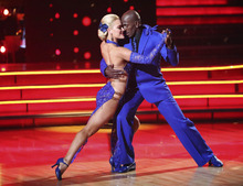 In this Monday, May 21, 2012 image released by ABC, Donald Driver, right, and his partner Peta Murgatroyd perform on the celebrity dance competition series