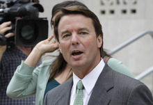 John Edwards leaves a federal courthouse after the jury deliberated for a third day in his trial on charges of campaign corruption in Greensboro, N.C., Tuesday, May 22, 2012. Edwards has pleaded not guilty to six counts related to campaign finance violations over nearly $1 million from two wealthy donors used to help hide the Democrat's pregnant mistress as he sought the White House in 2008. (AP Photo/Chuck Burton)