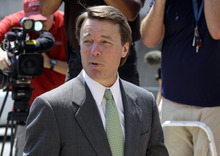 John Edwards speaks to the media as he returns from a lunch break at a federal courthouse as the jury deliberates for a third day in his trial on charges of campaign corruption in Greensboro, N.C., Tuesday, May 22, 2012. Edwards has pleaded not guilty to six counts related to campaign finance violations over nearly $1 million from two wealthy donors used to help hide the Democrat's pregnant mistress as he sought the White House in 2008. (AP Photo/Chuck Burton)