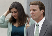 John Edwards, right, leaves a federal courthouse with daughter Cate Edwards, left, after the jury deliberated for a third day in his trial on charges of campaign corruption in Greensboro, N.C., Tuesday, May 22, 2012. Edwards has pleaded not guilty to six counts related to campaign finance violations over nearly $1 million from two wealthy donors used to help hide the Democrat's pregnant mistress as he sought the White House in 2008. (AP Photo/Chuck Burton)