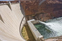 Tribune file photo Valves at the base of the Glen Canyon Dam are opened for a test flood of the Grand Canyon in 2008. A new Interior Department order will make these releases more common, benefitting fish and recreation.
