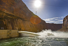 Tribune file photo Media and invited guests watch as the large valves are opened at the base of the Glen Canyon Dam in 2008, sending water at a rate of 41,00 cubic feet per second into the Colorado River. Such test floods will become more common under a new order to benefit fish and recreation.