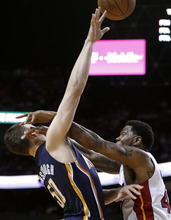 Indiana Pacers' Tyler Hansbrough (50) is fouled by Miami Heat's Udonis Haslem, right, during the first half of Game 5 of the NBA basketball Eastern Conference semifinal playoff series, in Miami on Tuesday, May 22, 2012. (AP Photo/Lynne Sladky)
