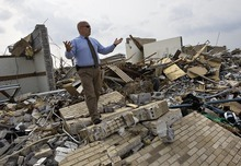 Salt Lake Tribune file photo  Joplin LDS Bishop Dave Richins stands on the rubble of the Joplin Second Ward of The Church of Jesus Christ of Latter-Day Saints in Joplin, Missouri, on Wednesday, June 1, 2011. The stake center was destroyed but Richins is confident his ward will recover.