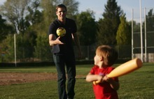 Kim Raff | The Salt Lake Tribune Josh Romney, son of presidential hopeful Mitt Romney, pitches a ball to his son, Nash, while at baseball practice for another son at a Holladay LDS stake house ball field. Josh Romney has been hitting the campaign trail for his father but tries to be home in Utah as much as possible for his family.