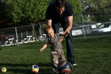 Kim Raff | The Salt Lake Tribune Josh Romney plays with his son Sawyer Romney while at another son's baseball practice at an LDS stake house in Holladay, Utah on May 3, 2012.
