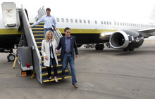 Republican presidential candidate, former Massachusetts Gov. Mitt Romney, his wife Ann and son Josh, arrive in Minneapolis, Wednesday, Feb. 1, 2012. (AP Photo/Gerald Herbert)