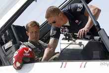 Francisco Kjolseth  |  The Salt Lake Tribune Police Officer Shawn Grogan of the Ogden-Weber Narcotics Task Force, gets last minute instruction from Raymond LeBlanc as he gets ready to fly in a Thunderbird F-16 with pilot Lt. Col. Jason Koltes as part of the Thunderbird's Hometown Hero Program on Thursday, May 24, 2012, out of Hill Air Force Base. Grogan was one of the officers injured in a raid back in January that killed a fellow officer.