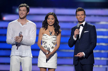 From left, finalists Phillip Phillips, Jessica Sanchez and host Ryan Seacrest appear onstage at the