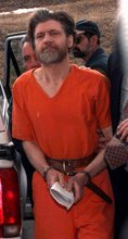 FILE - In this April 4, 1996 file photo, Ted Kaczynski, also known as the Unabomber, is escorted into the federal courthouse in Helena, Mont. Harvard alumni attending their 50th class reunion are getting updates on classmates _ including Kaczynski, who graduated in 1962. In an alumni directory, he lists his occupation as