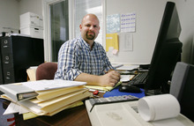 Steve Griffin/The Salt Lake Tribune    Business tax accountant, Chris Midgley, in his Salt Lake City, Utah office Wednesday May 23, 2012.