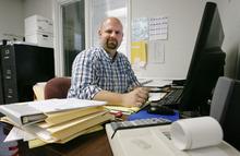 Steve Griffin/The Salt Lake Tribune    Business tax accountant, Chris Midgley, in his Salt Lake City, Utah office Wednesday May 23, 2012.