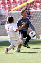 Kim Raff | The Salt Lake Tribune Olympus goalie Ethan Cash stops a shot by Murray player Alex Souvell during the 4A State Championship game at Rio Tinto Stadium in Sandy, Utah on May 24, 2012.  Olympus went on to win the game 3-2.