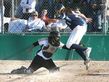 Paul Fraughton / Salt Lake Tribune Roy catcher Caylie Phelts  blocks home plate and makes the tag on Brooke Ford of Salem Hills .   Thursday, May 24, 2012
