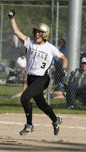 Paul Fraughton / Salt Lake Tribune As she rounds first base headed for second, Roy's Bryce Mitchell pumps her fist, celebrating her three run home run that gave her team the lead in the 4A championship game.   Thursday, May 24, 2012