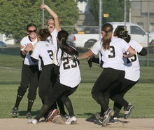 Paul Fraughton / Salt Lake Tribune Roy High School players converge in right field to celebrate their victory over Salem Hills High in the 4A softball championship game.   Thursday, May 24, 2012