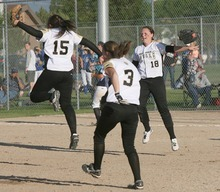 Paul Fraughton / Salt Lake Tribune Pitcher Jamie Aiken,15, Bryce Mitchell,3, and Kylee Blau,18,  leap into the air  after the final out giving  The Royals the State 4A Championship in softball.   Thursday, May 24, 2012