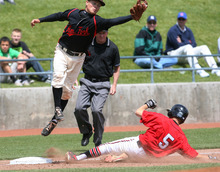Steve Griffin/The Salt Lake Tribune   Alta's Colton Nash slides under American Fork's Jeremy Reynolds after hitting a triple during their 5A playoff game at Kearns High School in Kearns, Utah Thursday May 24, 2012.