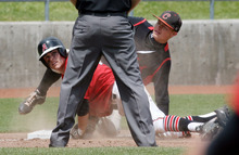 Steve Griffin/The Salt Lake Tribune    Alta's Braydon Goddard looks back at the umpire to see that he is safe at third during their 5A playoff game against Lone Peak at Kearns High School in Kearns, Utah Thursday May 24, 2012. American Fork's Jeremy Reynolds.