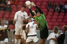 Kim Raff | The Salt Lake Tribune Davis goalkeeper Mitch Jensen catches the ball over the heads of (left) Skyler Milne and Daniel Baggaley during a Brighton corner kick during the 5A State Championship game at Rio Tinto Stadium in Sandy, Utah on May 24, 2012. Davis went on to win 1-0.