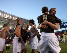 Kim Raff | The Salt Lake Tribune Davis players (back) John Taylor and Scot Felsted celebrate defeating  Brighton during the 5A State Championship game at Rio Tinto Stadium in Sandy, Utah on May 24, 2012. Davis went on to win 1-0.
