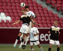 Kim Raff | The Salt Lake Tribune (left) Davis player John Taylor and Brighton player (right) Skyler Milne battle for a ball in the air during the 5A State Championship game at Rio Tinto Stadium in Sandy, Utah on May 24, 2012. Davis went on to win 1-0.
