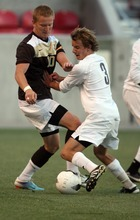 Kim Raff | The Salt Lake Tribune (left) Davis player John Taylor and Brighton player Andrew Campbell battle for a ball during the 5A State Championship game at Rio Tinto Stadium in Sandy, Utah on May 24, 2012. Davis went on to win 1-0.