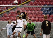 Kim Raff | The Salt Lake Tribune (top) Davis player Taylor Flitton gets a head on the ball over Brighton player Daniel Baggaley during the 5A State Championship game at Rio Tinto Stadium in Sandy, Utah on May 24, 2012. Davis went on to win 1-0.