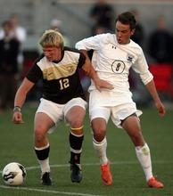 Kim Raff | The Salt Lake Tribune (left) Davis player Chance Parker dribbles the ball as Brighton player Stephen Hogan defends during the 5A State Championship game at Rio Tinto Stadium in Sandy, Utah on May 24, 2012. Davis went on to win 1-0.