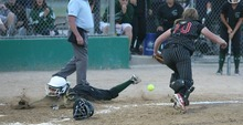Paul Fraughton / Salt Lake Tribune Copper Hills base runner Skyler Cook dives head first across home plate as Weber catcher Haylee Chugg  looks for the ball.    Thursday, May 24, 2012