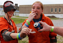 Trent Nelson  |  The Salt Lake Tribune Weber State students Rachel Taylor and Sarah Cleverley pour Pepsi into their mouthpieces in preparation for role playing as inmates in a scenario at the Mock Prison Riot, Monday, May 7, 2012 at the West Virginia Penitentiary in Moundsville, West Virginia.