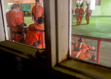 Trent Nelson  |  The Salt Lake Tribune Volunteers role playing as inmates wait in a dining hall prior to an emergency response training scenario at the Mock Prison Riot, Monday, May 7, 2012 at the West Virginia Penitentiary in Moundsville, West Virginia.