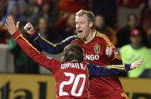 Rick Egan  | The Salt Lake Tribune   Nat Borchers (6) celebrates with Real Salt Lake midfielder Ned Grabavoy (20) after scoring the game winning goal, to give Real Salt Lake a 3-2 win over FC Fallas, in MLS soccer action, Real Salt Lake vs FC Dallas, in Sandy, Saturday, May 26, 2012.
